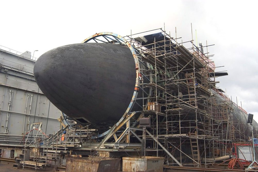 submarine at dock with scaffolding around it