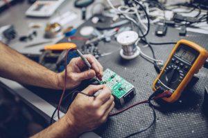 man working with circuit board